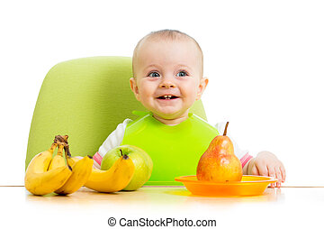 happy baby eating fruits