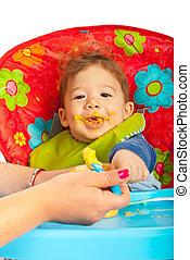 Happy baby eating puree