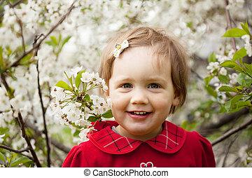 Happy baby girl in spring