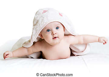 happy baby girl in towel