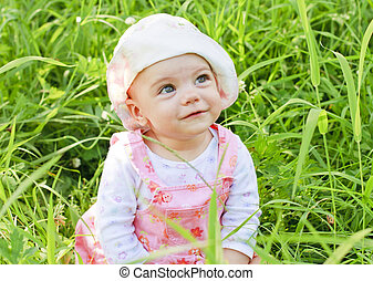 Happy baby girl with blue eyes