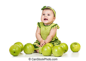 happy baby  girl with green apples isolated on white background