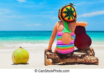 Happy baby have fun on summer tropical beach holiday