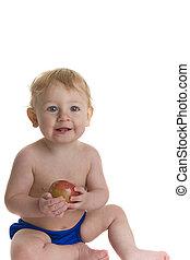Happy baby holds apple