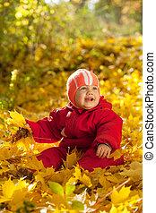 happy baby in autumn park