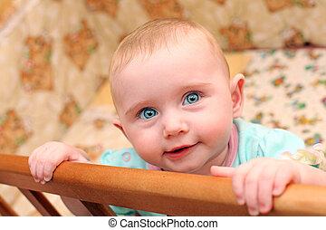 Happy Baby in Bassinet