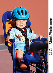 happy baby in bicycle chair
