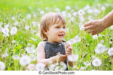 happy baby in meadow