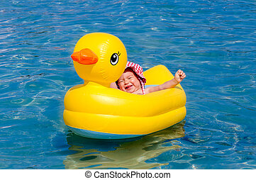 Happy baby in the boat