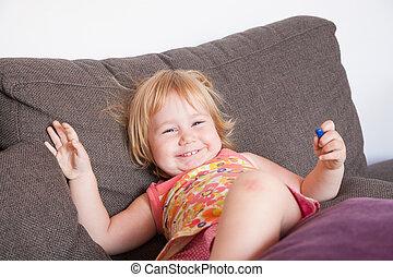 happy baby on sofa
