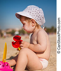 happy baby on the beach