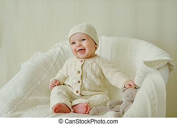 happy baby on the chair