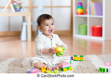 Happy baby playing in the constructor - Happy baby playing...