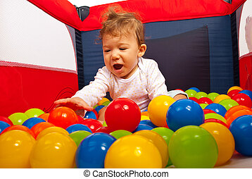 Happy baby playing with balls