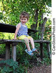 happy baby sitting in garden