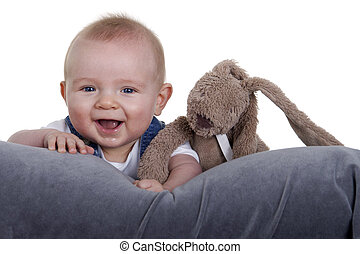 happy baby with stuffed animal