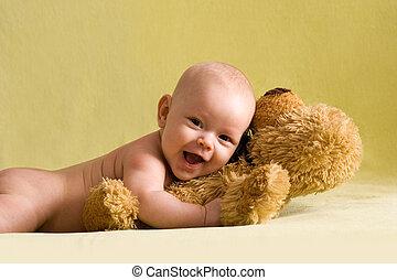 Happy baby with Teddy bear