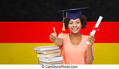 happy bachelor girl with diploma showing thumbs up