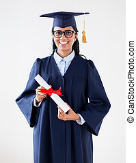 happy bachelor woman in mortarboard with diplomas