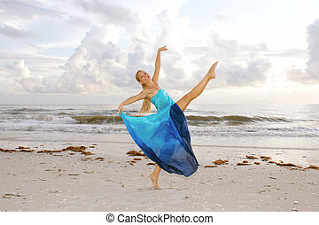 happy ballerina on beach