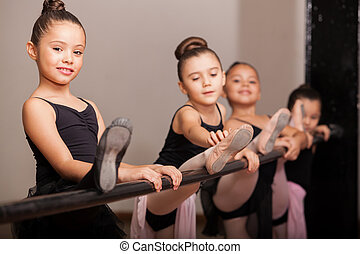 Happy ballet dancer during class - Cute little girl loving...