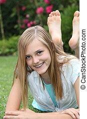 Happy barefoot carefree teenage girl