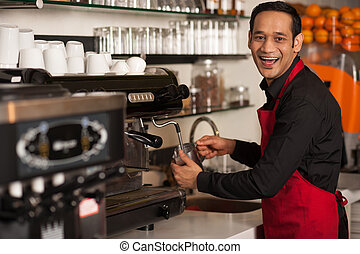 Cheerful male staff preparing customers order