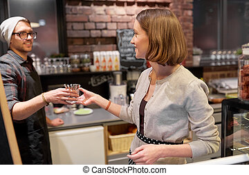 happy bartenders at cafe or coffee shop - small business,...