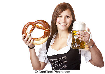 Happy Bavarian woman holding Oktoberfest beer stein and...