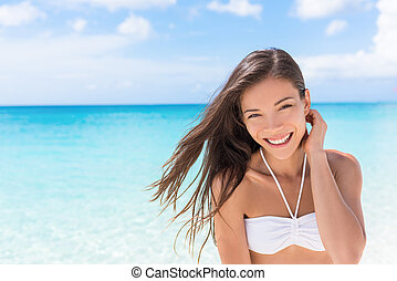 Happy beach Asian woman living a healthy lifestyle