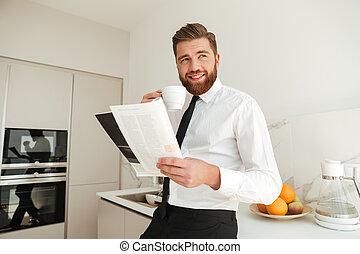 Happy bearded business man drinking coffee