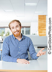 Happy bearded businessman talking and smiling in office