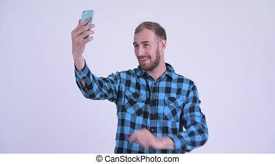 Happy bearded hipster man taking selfie