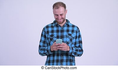 Happy bearded hipster man using phone