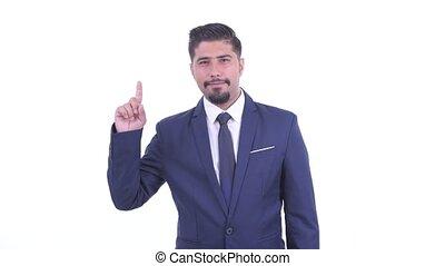 Happy bearded Persian businessman pointing up - Studio shot...