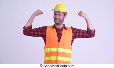 Happy bearded Persian man construction worker flexing both...