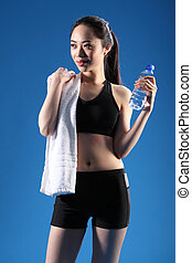 Happy beautiful Asian girl after fitness workout