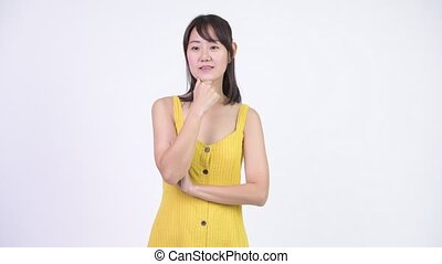 Happy beautiful Asian woman thinking and pointing up -...