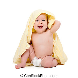 happy beautiful baby in yellow towel isolated