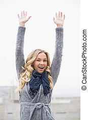 Happy beautiful blonde posing outdoors