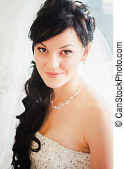 Happy beautiful bride blond girl in white wedding dress with hairstyle