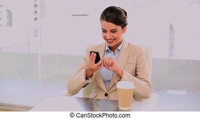 Happy beautiful businesswoman drink