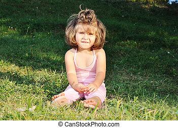 Happy beautiful child on ground outdoor