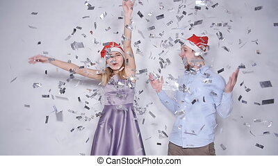 Happy Beautiful couple in Santa hats dancing and smiling