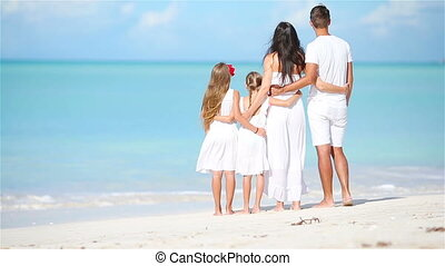 Happy beautiful family on white beach - Happy beautiful...