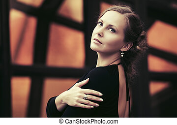 Happy beautiful fashion woman in black dress