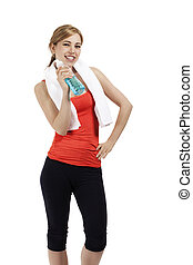 happy beautiful fitness woman with a bottle of blue water on white background