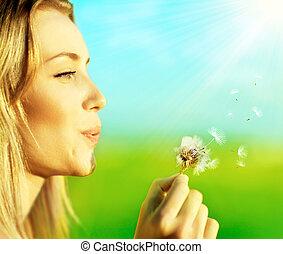 Happy beautiful girl blowing dandelion Happy beautiful stock