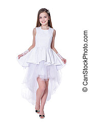 Happy beautiful little girl in white dress posing on white background