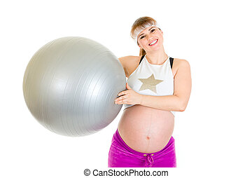 Happy beautiful pregnant woman  in sportswear holding fitness ball isolated on white